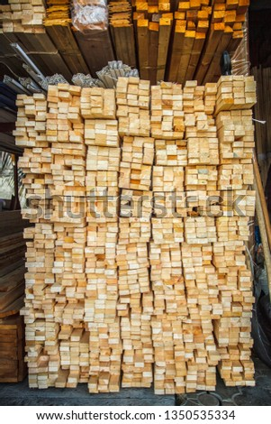 Wooden planks. Beams. Air-drying timber stack. Wood air drying (seasoning lumber or wood seasoning). Timber. Lumber. Close-up.