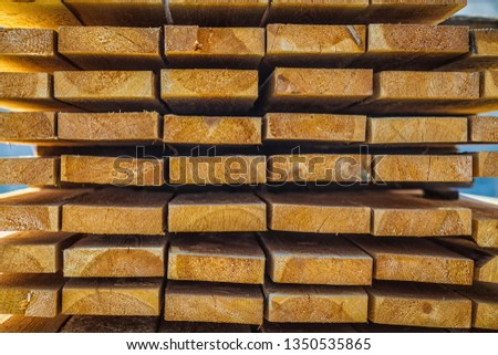 Wooden planks. Beams. Air-drying timber stack. Wood air drying (seasoning lumber or wood seasoning). Timber. Lumber. Close-up. Texture