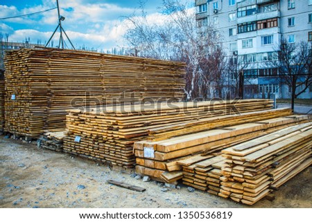 Wooden planks. Beams. Air-drying timber stack. Wood air drying (seasoning lumber or wood seasoning). Timber. Lumber.