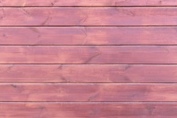 Wooden planks, lining, boards for construction works in the sawmill. Wooden brown background