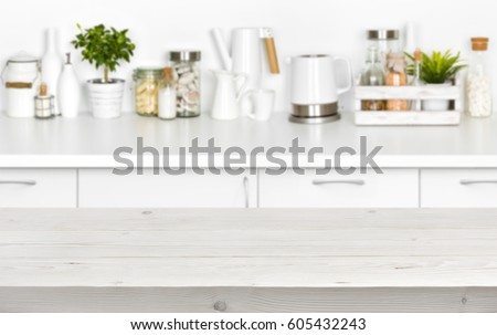 Shutterstock Wooden planks table over blurred image of kitchen bench interior