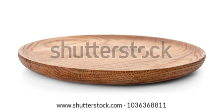 Wooden plate on white background. Handcrafted cooking utensils