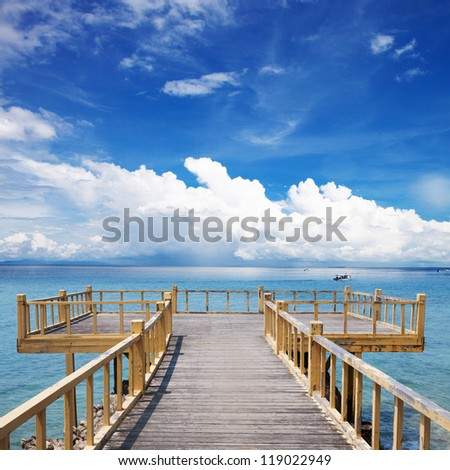 wooden platform beside beach