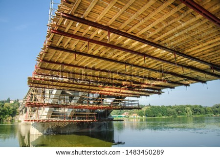 Wooden platform for installing formwork and scaffolding during the reconstruction of the bridge