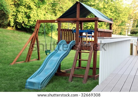 Wooden playset in a backyard