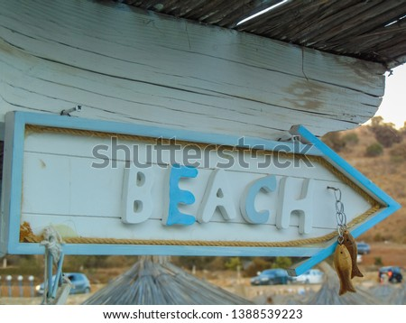 Wooden pointer to the beach #1388539223