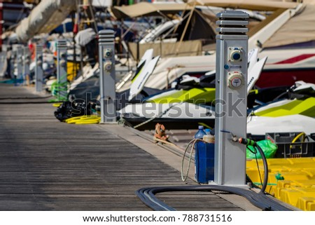 Wooden port bridge with chargers to yachts in Puerto De Mogan on Gran Canaria. #788731516