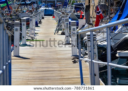 Wooden port bridge with chargers to yachts in Puerto De Mogan on Gran Canaria. #788731861