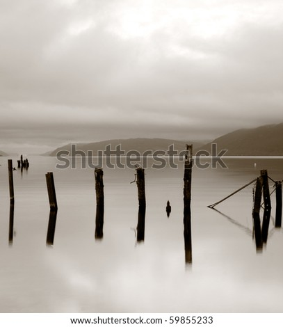 Wooden posts in lake. (Loch Ness, Scotland)