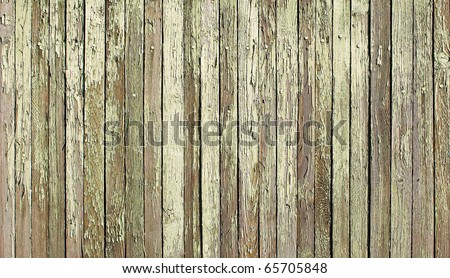 Wooden protection on all background, with traces of a green paint