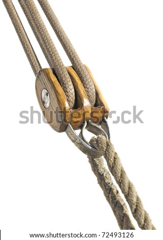 Wooden pulley with ropes isolated over white