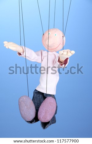 Wooden puppet on blue background