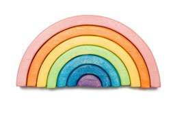 Wooden puzzle in the form of a rainbow isolated on white. Multicolored toy.