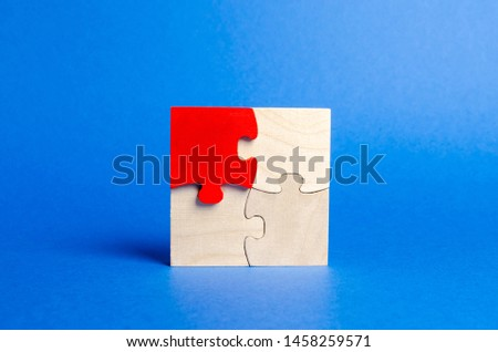 Wooden puzzles on a blue background. One puzzle is different. Individual opinion. Stand out from the crowd. Uniqueness. Divergent views. Different concepts to other people. Place for text.