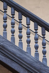 Wooden Railing of an antique staircase (close up view)