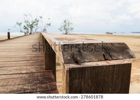 wooden railing on wood bridge,thailand