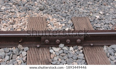 Photo of  wooden railway and stone peddles