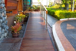 Wooden ramp way for support wheelchair disabled people in resort