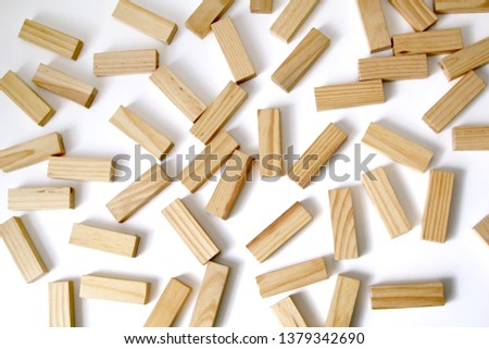 Wooden rectangles arranged differently over a white background. Copy space. Cover background template for the presentation, brochure, web, banner, catalog, poster, book, magazine  #1379342690