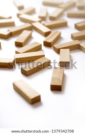 Wooden rectangles arranged differently over a white background. Copy space. Cover background template for the presentation, brochure, web, banner, catalog, poster, book, magazine  #1379342708