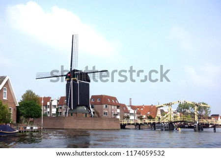 Wooden Rembrandt drawbridge and the 17th century post mill \