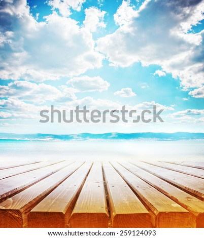 wooden retro deck and blue sky and sea/ Summer holidays background