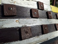 Wooden rivets on Board a wooden brown ship. Shipbuilding. Design.