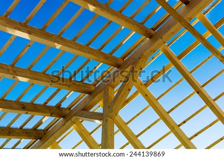 wooden roof construction, symbolic photo for home, house building, and house financing