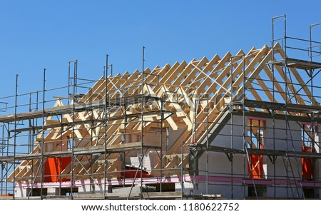 wooden roof framework with dormers