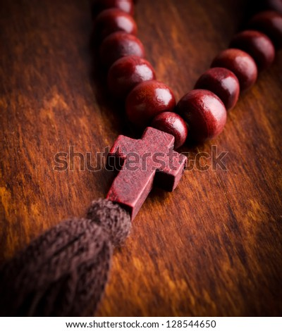Wooden rosary and cross closeup