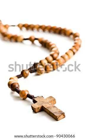 Wooden rosary beads on white background