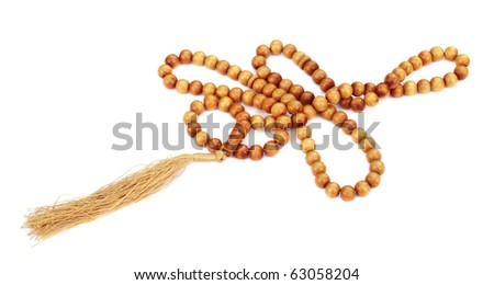 Wooden rosary over white background