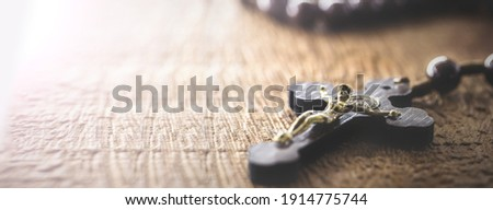 wooden rosary radiated by divine light, concept of faith and spirituality, copy space Stock photo ©