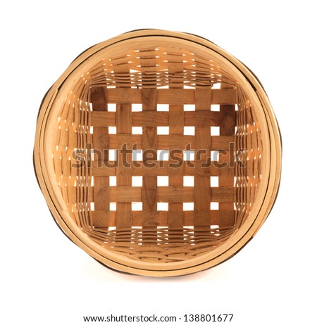 Wooden round wicker basket isolated over white background, top view