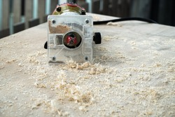Wooden router machine with the sawdust pile on the wood table