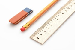 wooden ruler a simple pencil and eraser on a white background