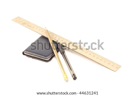 wooden ruler, notepad, pencil and pen on a white background