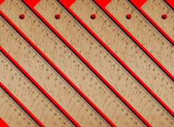 wooden rulers lined up in a pattern over a background