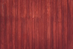 Wooden rural wall outside of red barn in Scandinavia. Background texture.