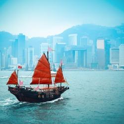 wooden sailboat sailing in victoria harbor at Hong Kong