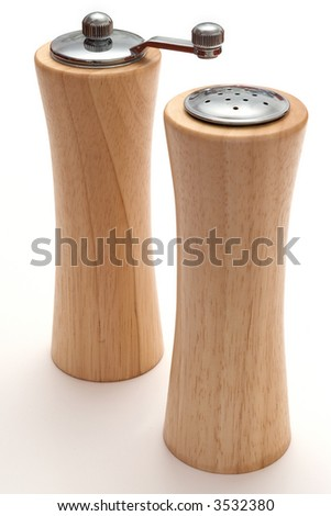 Wooden salt and pepper pot over white background