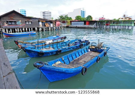 Wooden sampan boat anchored to the pier in the Chew Jetty, a UNESCO heritage site, in Penang, Malaysia.