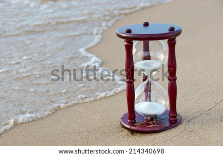 wooden sand timer at the seashore