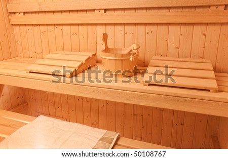 Wooden sauna cabin with seats