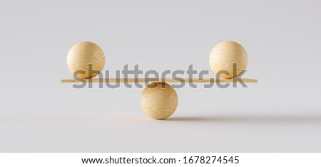 Photo of  wooden scale balancing two big wodden balls. Concept of harmony and balance