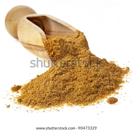 wooden scoop with curry powder isolated on white background