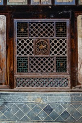 Wooden sculpture decoration in ancient Chinese Windows.