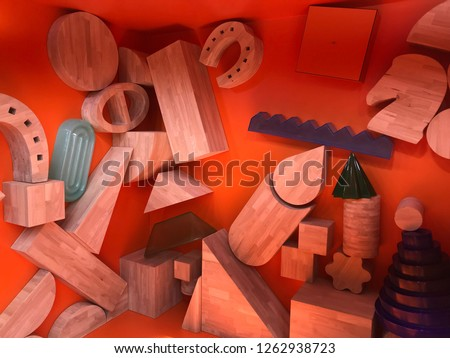 Wooden shapes, triangles, semi-circles, circles, cylinders, square, cones, rectangles, toys, decorative elements with red background, design stock photo image  #1262938723