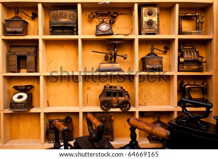 Wooden shelf full of antiques and vintage objects