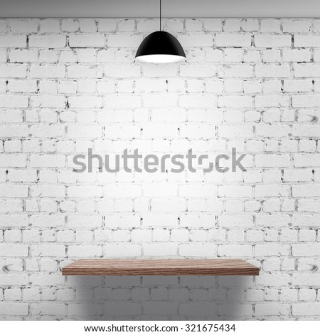 Wooden shelf over white brick background with lamp #321675434